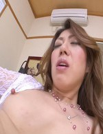 Reina Nishio Asian teases hard nipples and cooter with vibrator