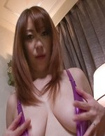 Araki Hitomi Asian fucks her vagina with dildo through crotchless