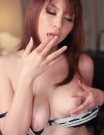 Araki Hitomi sucks vibrator and fucks herself with a big one