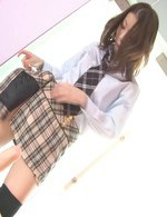 Nao Kojima Asian in long socks fucks her vagina with fake penis
