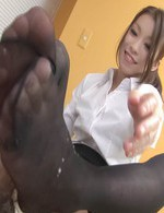Nao Kojima Asian rubs cock with feet in nylon and rides it then