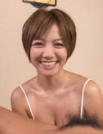 Meguru Kosaka holds penis between her boobs and licks its head