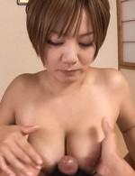 Meguru Kosaka Asian teases dick with hot tits and sucks it well