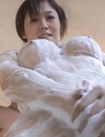 Mai Hanano Asian sucks balls and rubs penis between big knockers