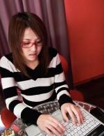 Glass clad Japanese babe Rino Mizusawa toying her pussy