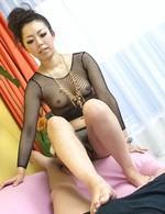 Yuki Asami Asian in fishnet blouse licks tool and teases balls