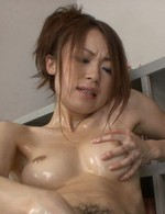 Sara Seori Asian slowly teases her hairy cunt with oiled fingers