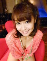 Maika Asian with cans in fishnet blouse puts vibrator on beaver