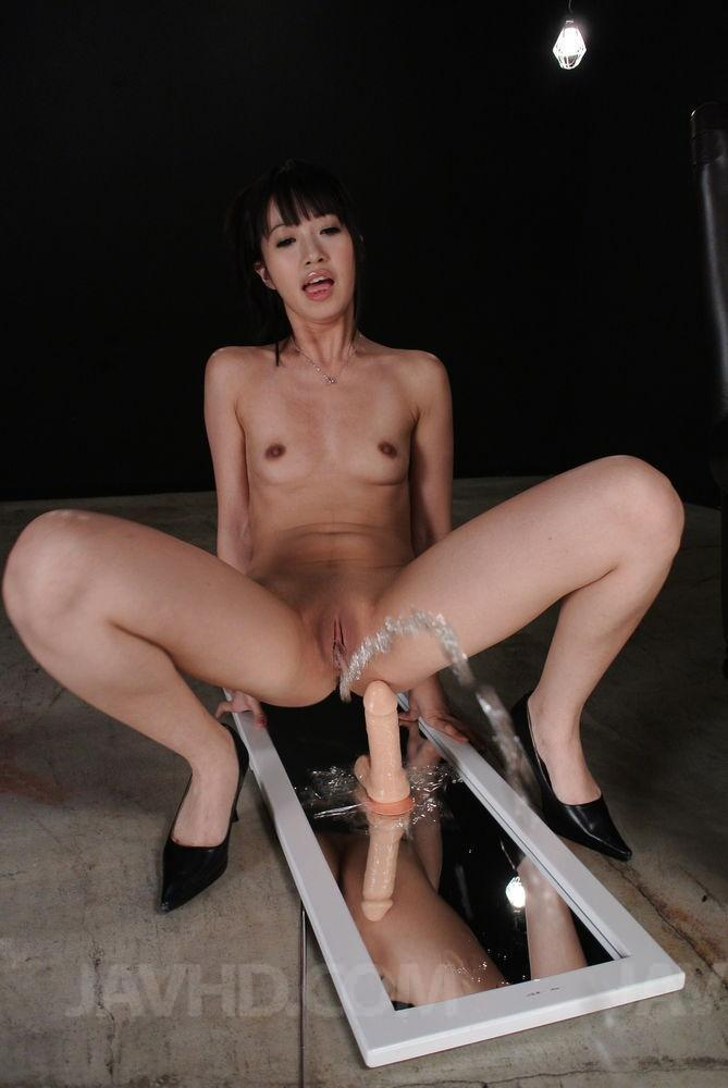asian squirting dildo Asian sweetheart Aoi Yuuki masturbates fucking her shaved pussy.