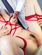 Sara Yurikawa in red ropes is aroused with vibrators and fucked