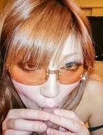 Mariko with sunglasses licks balls and cock and rides phallus