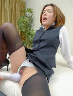Emi Orihara Asian has stockings ripped and gets vibrator on cunt