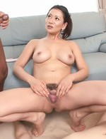 Rei Kitajima Asian with wet big boobs sucks and rubs two penises