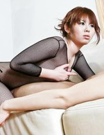 Reina Sakai Asian in fishnet jumpsuit is dedicated to blowjob