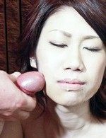Huuka Takanashi Asian sucks and rubs two penises and gets cum